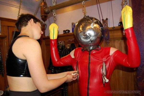 AliceInBondageLand - Latex Makeover - EXTREME Metal Hood - FemDom Threesome